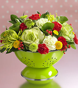 Come to think of it, any old kitchen vessel can make a charming floral display. Using a colander as a vase is one way, which also happens to make a great housewarming gift. Source