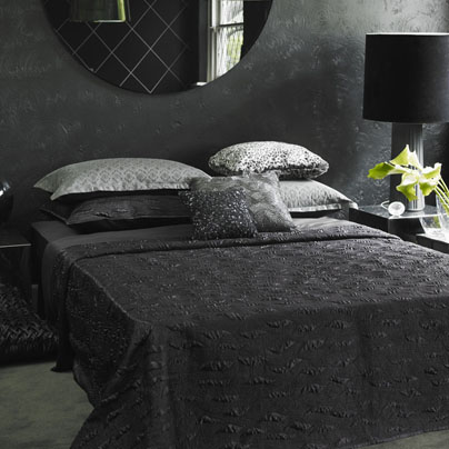 Perhaps there is a way to go too black . . . With black bedding, lamps, walls, and accent art, this room is positively goth.  Source