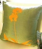 This Olive Green Orchid Pillow ($35) has a stunning, cheerful silhouette.