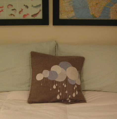 This cute When It Rains Pillow ($25) will add some fun, cloudy shapes to your sofa or bed.