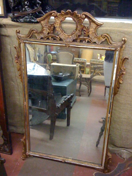 This Antique Gilt Frame Mirror With Mirror Inlay ($800) is from the early 20th century and is delicately dramatic.