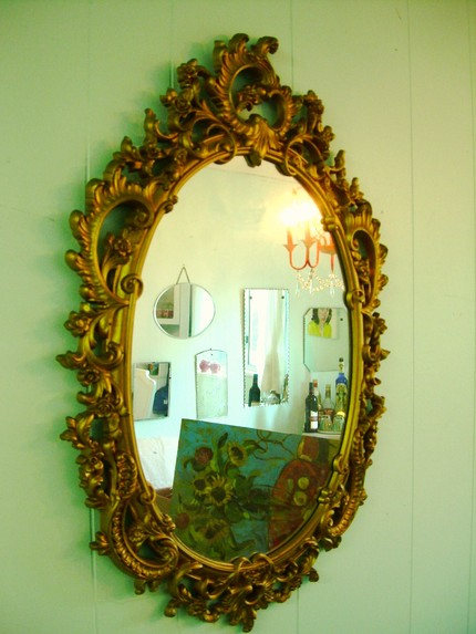 This 29-by-19 Vintage Syroco Mirror ($55) is very ornate with a gold finish that will glam up any room.