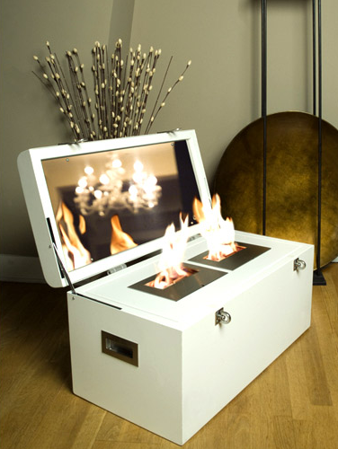 The Malle à Feu ($5,400) is a simple white trunk that opens to reveal burns a two-flame ethanol fire inside.
