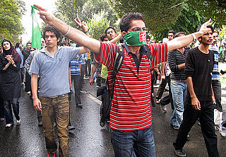 Front Page: Iranians Clash as Ahmadinejad Denies Holocaust