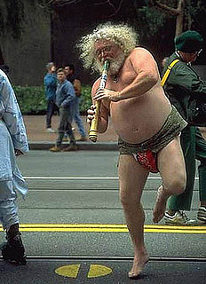Man Playing Flute in Street