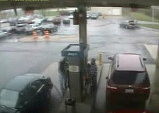 Man Pushes Red Button at Gas Station