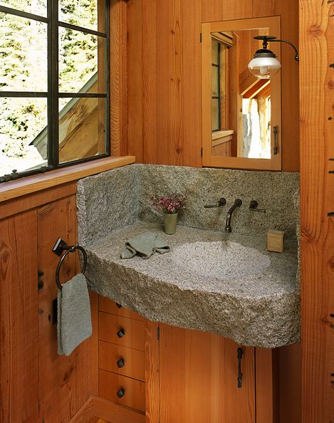 The natural, rough look of the stone perfectly complements the rustic wood paneling.