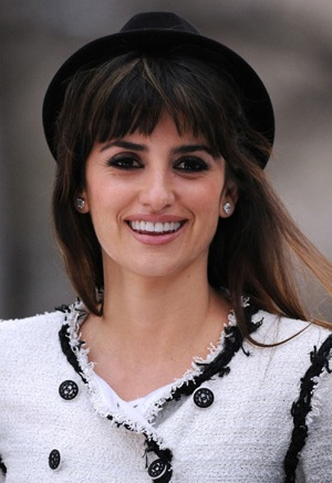 Penelope Cruz Opens the Unbreakable Kiss Mistletoe Installation in Madison Square Park in a White Chanel Suit and Hat