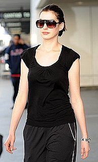 Anne Hathaway at LAX in Black Plastic Sunglasses
