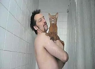 Man Takes His Cat in the Shower