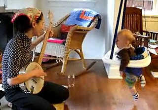 Baby Bounces While Mom Plays the Banjo