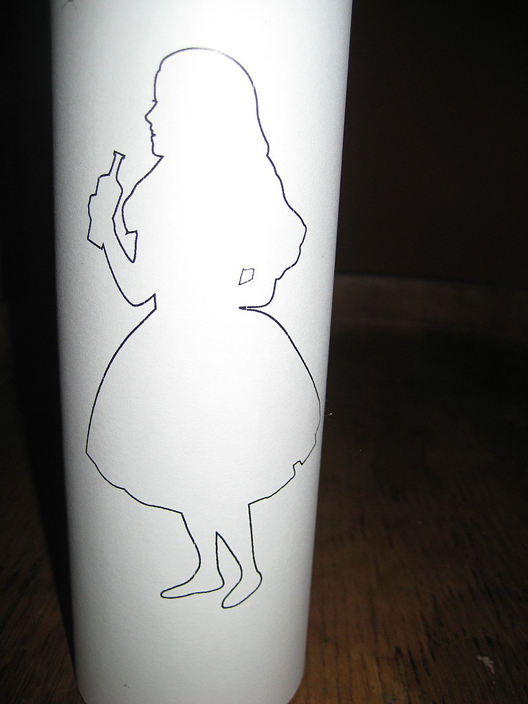 The Alice in Wonderland logo was printed on thin paper. We covered Mexican saint candles with these.