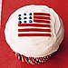 Red licorice laces double as the flag's stripes on this adorable cupcake.