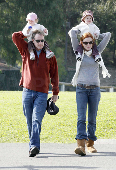 Marcia Cross and her husband, Tom Mahoney took their twins, Savannah and Eden on shoulder rides through the park.