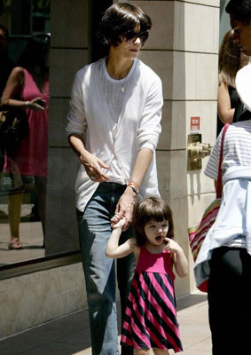 Katie and Suri Stride Down the Sidewalk
