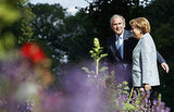 Bush and German Chancellor Angela Merkel walk around the gardens at the guest house of the Federal Republic.