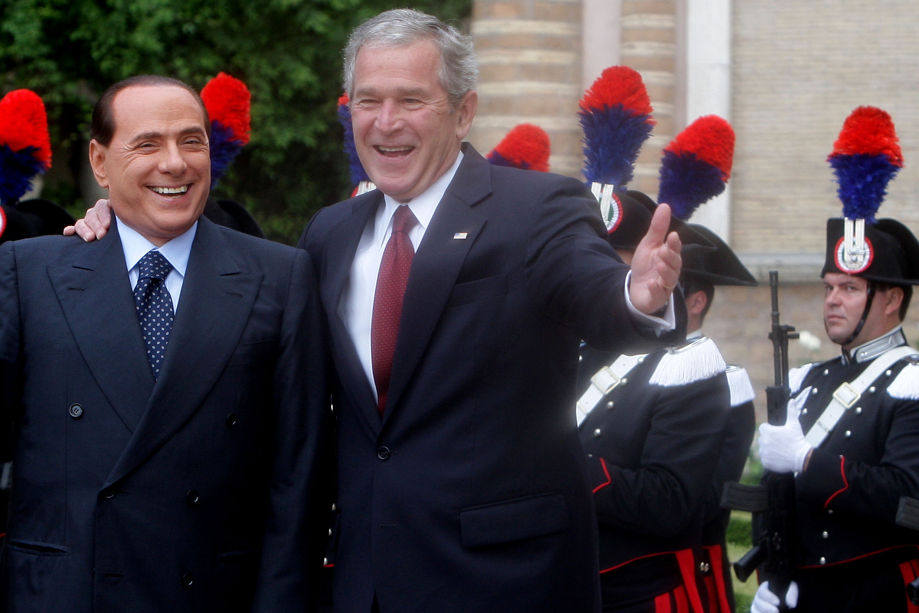 Italian Prime Minister Silvio Berlusconi stands with Bush as he arrives at Villa Madama, June 12, 2008.