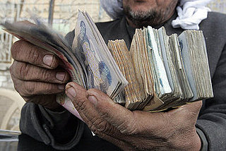 More Money, Less Problems? Iraqi Officials Hand Out Cash
