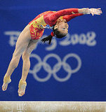 China's Deng Linlin competes on the beam.