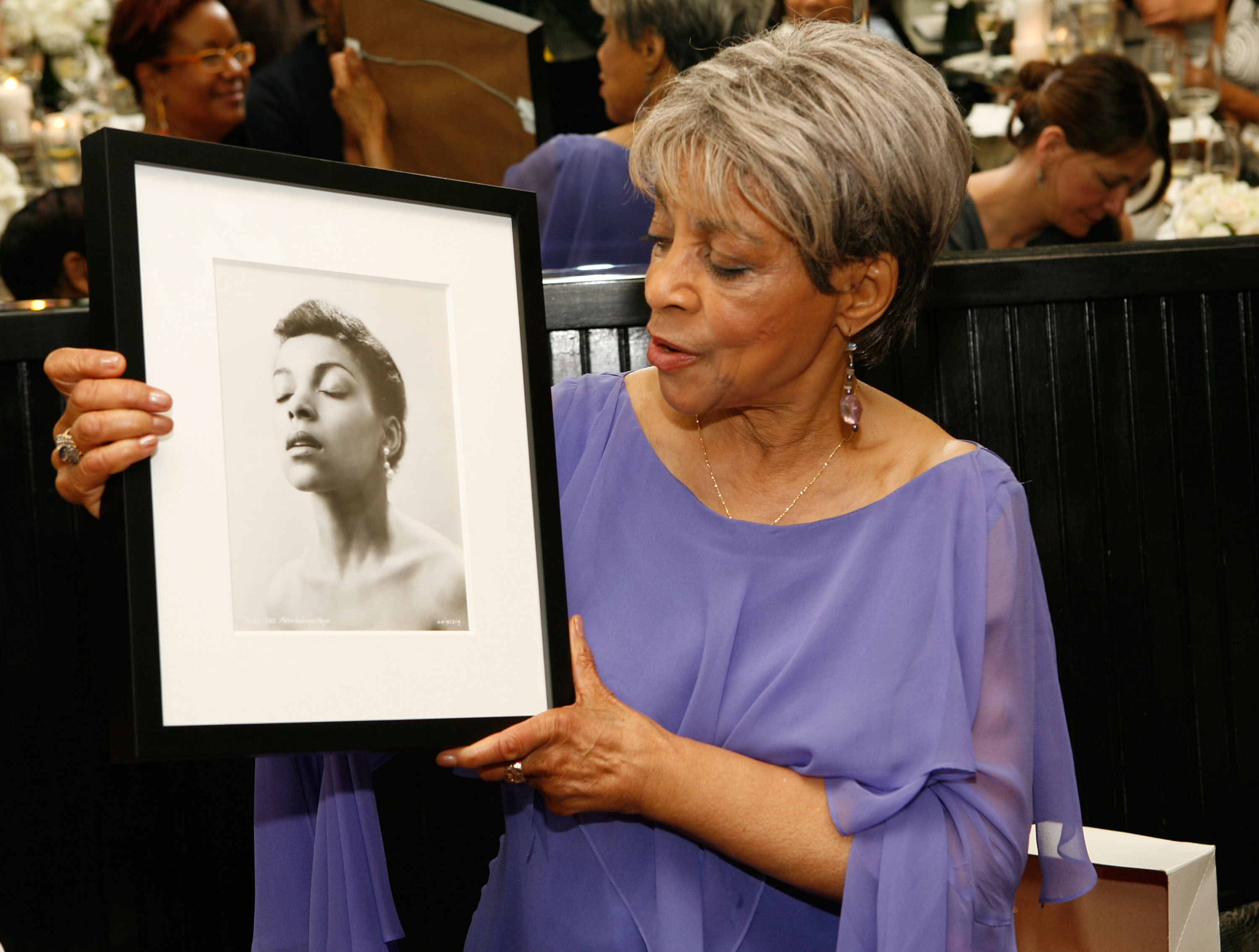 Checking a picture of her younger self out at the Ruby Dee Style Celebration in June, 2008.