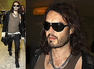 Photos of Russell Brand Arriving at Heathrow Airport