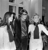 1968: Yves Saint Laurent with Lauren Bacall and her daughter after a showing of his latest collection in Paris.
