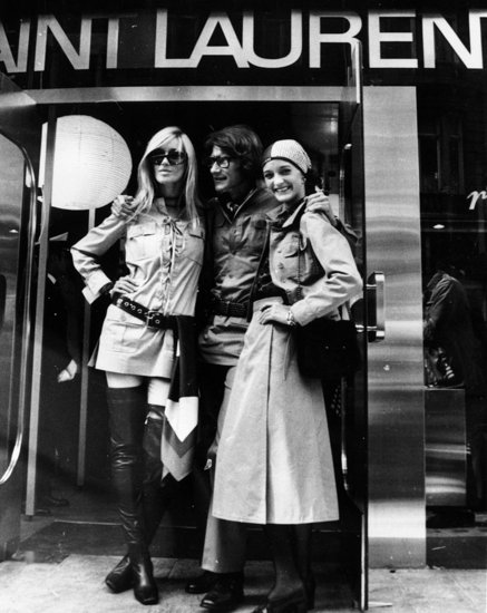 1969: Yves Saint Laurent flanked by muses Betty Catroux and Loulou de la Falaise outside his new shop on New Bond Street, London