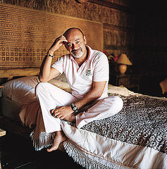 Christian Louboutin in his bedroom in Portugal, shot by Mary Rozzi for domino magazine.