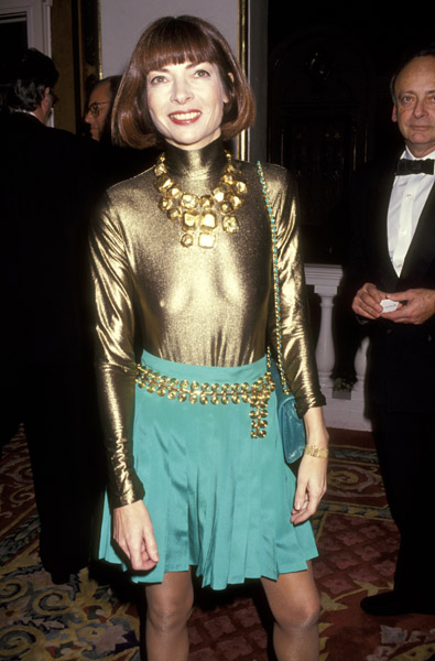 Nov. 1991: Sheer gold at a holiday benefit, with then-husband David Shaffer fading into the background.