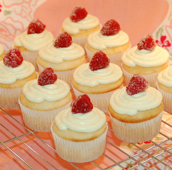 Lemon cupcakes with lemon buttercream and sugared raspberries.