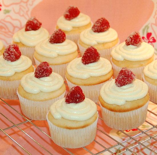 Lemon cupcakes with lemon buttercream and sugared raspberries.