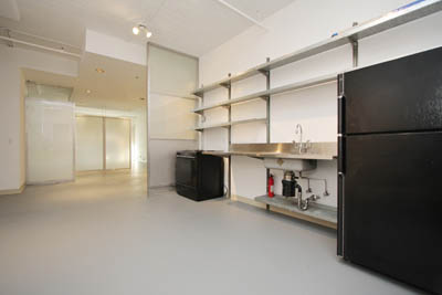 As you can see, it was a drab kitchen with a basic electric stove, painted white and with cold galvanized steel shelves.
