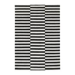 Put a graphic rug down for your calming white room with the Stockholm Rand Rug ($179).