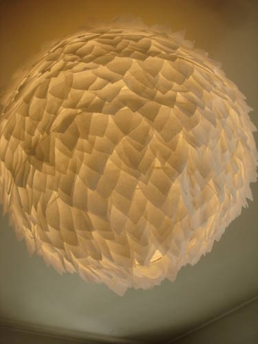 Craftster member LilChick made this amazing lamp from a paper lantern and tiny pieces of cut silk paper. Learn how to make your own.