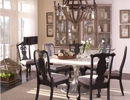 Mix-and-match dining room chairs are united by a coordinated color palette.