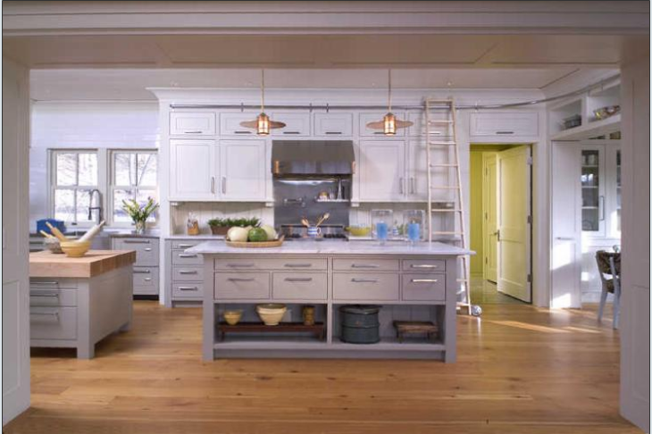 A rolling library ladder makes accessing hard-to-reach cabinets in the kitchen and the pantry a snap. A large kitchen island and plentiful counterspace allows for kitchen entertaining while cooking.