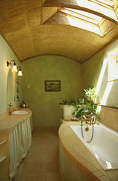 The use of natural finishes keeps the indoor air quality of the home incredibly high, while architectural details such as the bathroom skylight provide daylighting, which reduces the need for electrical lighting.