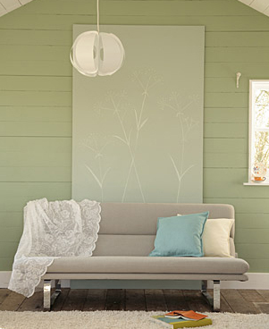 Soothing colors make this corner a place to sit down and stay awhile, preferably with a great book.