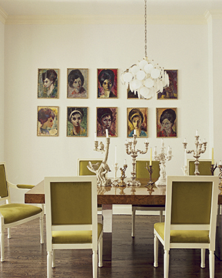 In the dining room, a '70s light fixture, set of lady portraits, and a series of candelabras take center stage, while olive green chairs infuse color.