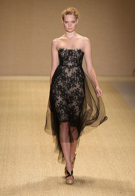 Short, sweet, and edgy in black lace and tulle, this dress has a mesmerizing effect.