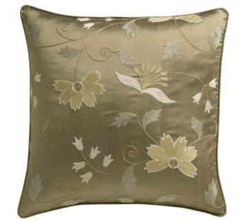 The bronze dupioni silk Crate & Barrel Madeline Pillow ($69.95) with crewel-stitched botanicals in vintage golds and taupes mimics the palette and florals of the tulle gown.