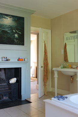 A fireplace in the bathroom makes things toasty on chilly winter days.