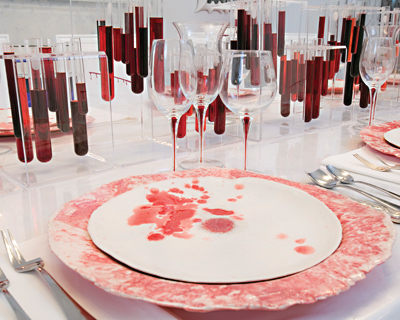 Test tubes with faux vital fluid make an artful yet gruesome centerpiece.