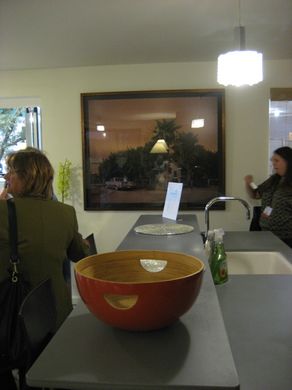 The kitchen counter is by EcoTop. My eyes were also drawn to the gorgeous, oversize photograph in the center background.