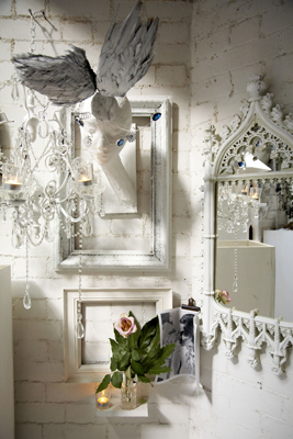 A collection of decorative white elements makes an eclectic display.