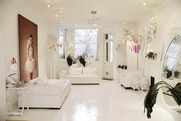 Glossy floors and a palette of all white are an ideal canvas for large format artwork and oversized mirrors.