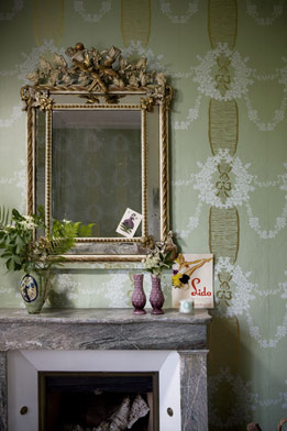 With an intricate, gilded mirror hanging above your mantel, you need little more than a vase of fresh flowers to finish off the look.
