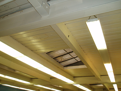 I actually love the painted wooden ceiling at the Boys and Girls Club, but changing out the fluorescent lights would be a definite improvement. I wonder if the designer will change them out? (Want to know who the designer is? Keep reading!)