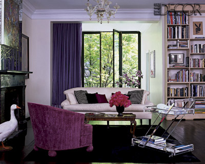 A life-like goose and a flea market Lucite bar cart used to store coffee table books bring eccentricity to this living room.