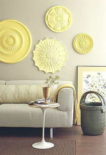 Use ceiling medallions for wall art. Source